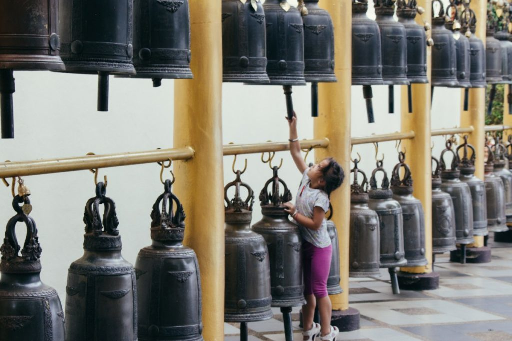 Girl ringing bells in Doi Suthep