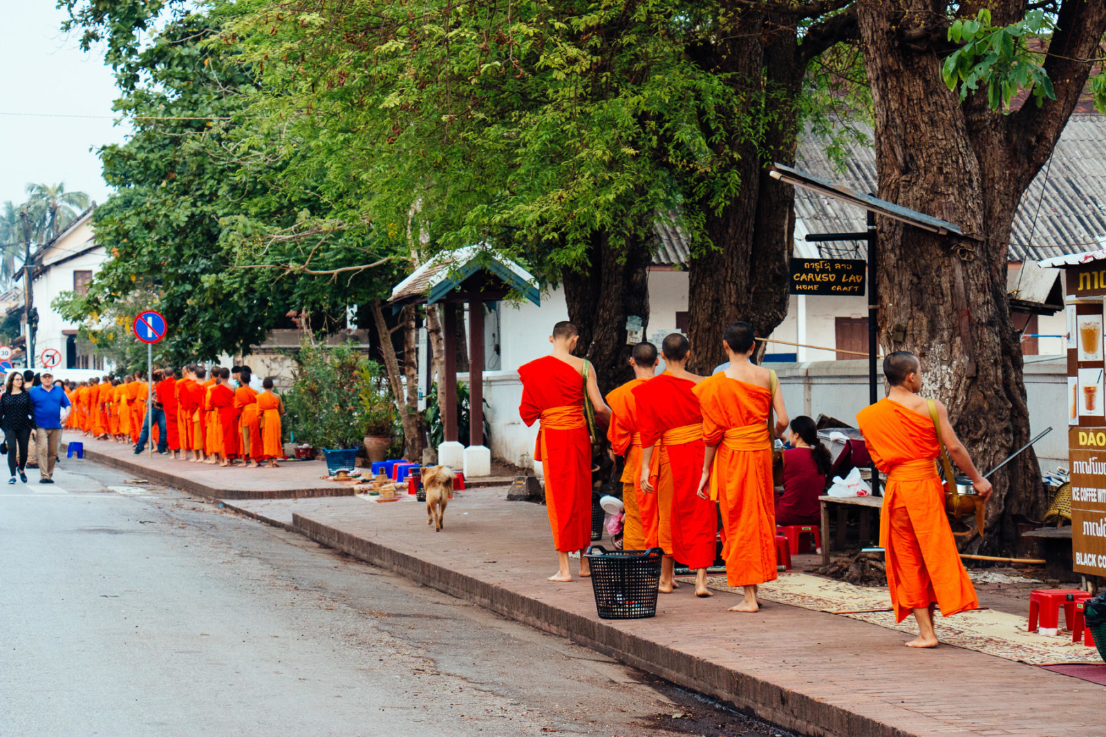 Monks walking, alms procession
