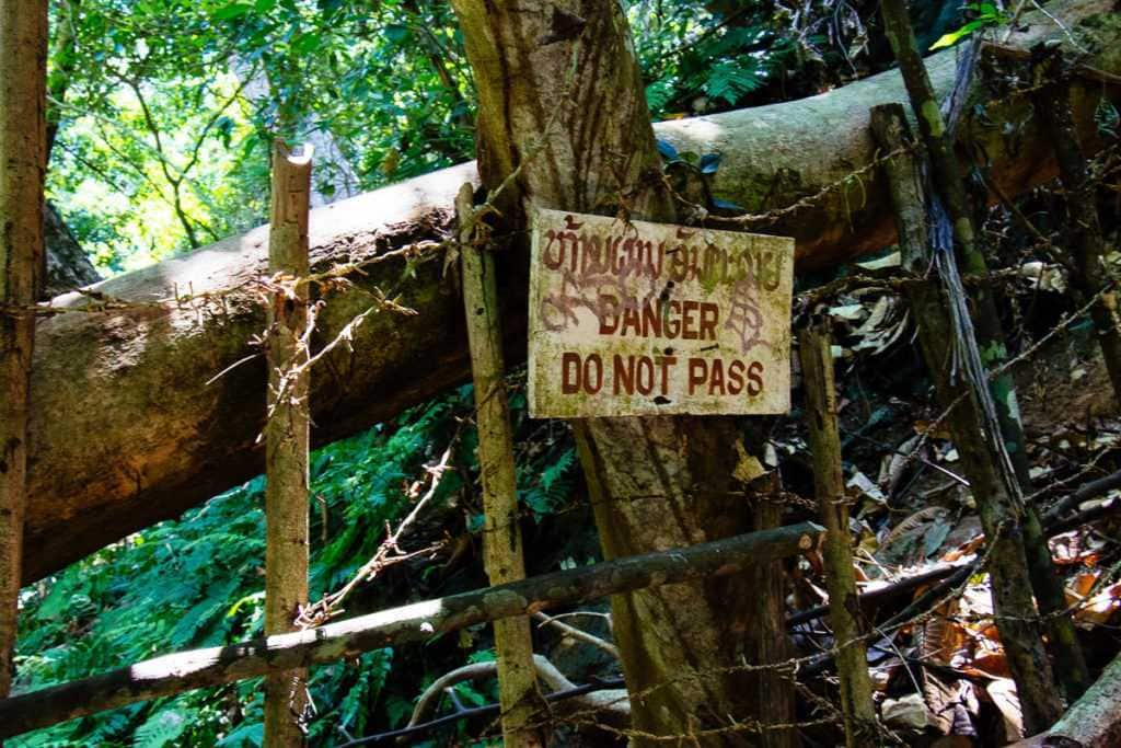Danger sign at Kuang Si Waterfall in Lao