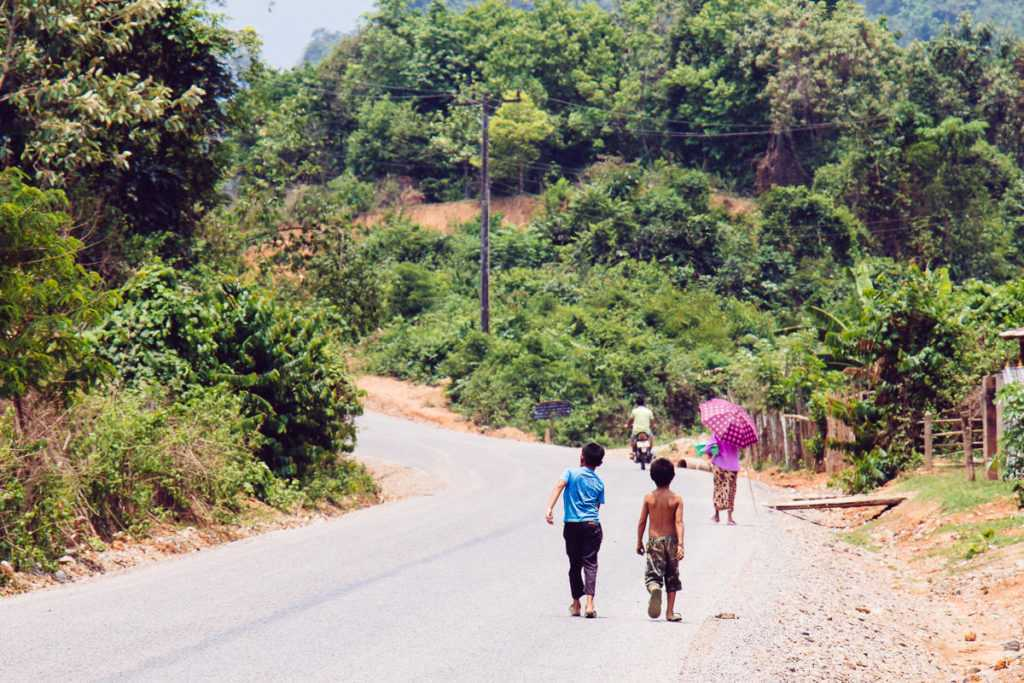 Kids walking down the road in Lao