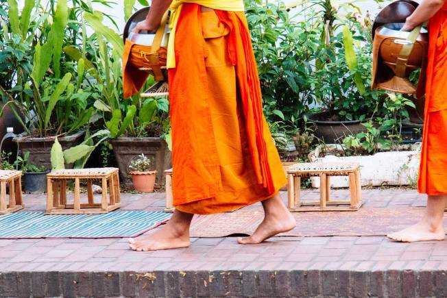 The awkward monk procession in Luang Prabang