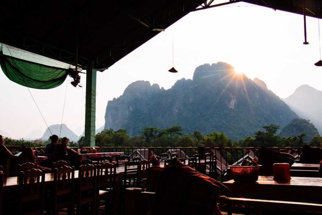 Sunset behind karst mountains in Vang Vieng, Lao