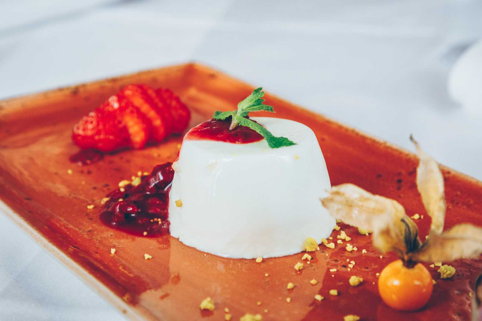 panna cotta cucumber thyme with physalis and strawberry