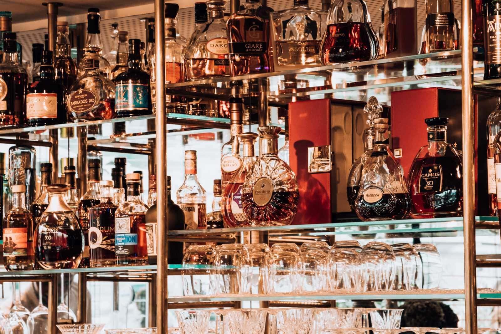 Shelves with bottles Seven Senses Bar Salzburg